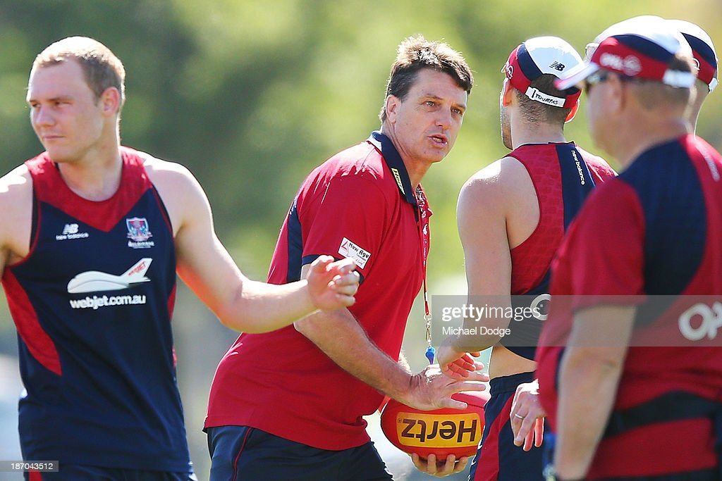 Coach <a gi-track='captionPersonalityLinkClicked' href=/galleries/search?phrase=Paul+Roos&family=editorial&specificpeople=193840 ng-click='$event.stopPropagation()'>Paul Roos</a> teaches speaks to a player during a Melbourne Demons AFL training session at Gosch's Paddock on November 6, 2013 in Melbourne, Australia.