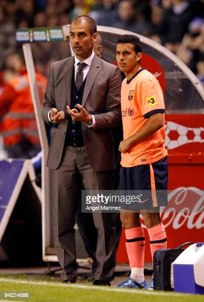 Coach Pep Guardiola of Barcelona gives instructions to Pedro Rodriguez during the La Liga match between Deportivo La Coruna and Barcelona at the...