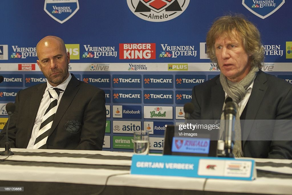 coach Peter Bosz of Heracles Almelo, coach Gert Jan Verbeek of AZ during the Dutch Eredivisie match between Heracles Almelo and AZ Alkmaar at the Polman Stadium on march 31, 2013 in Almelo, The Netherlands