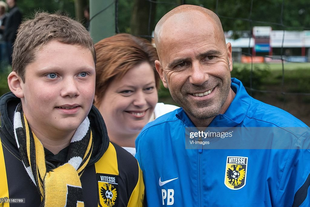 coach Peter Bosz of Vitesse with a supporter during the pre season friendly match between on June 20, 2013 at Sportpark de Bree West in Scherpenzeel , The Netherlands.
