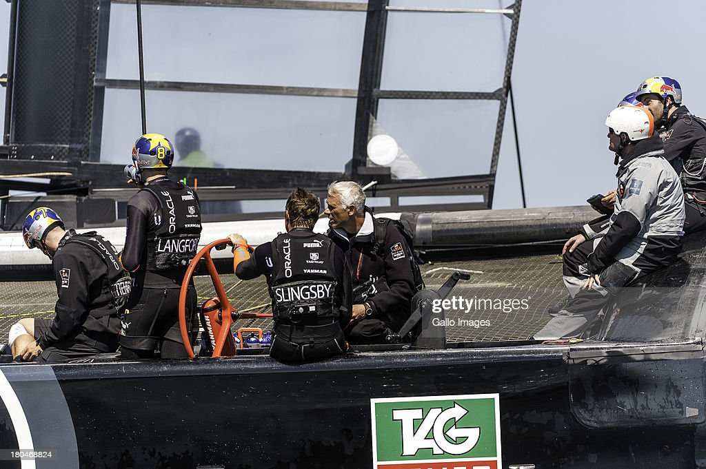 USA coach Philippe Presti talks to tactician Tom Slingsby in between races 6 and 7 during day 4 of the America's Cup on September 12th, 2013 in San Francisco.