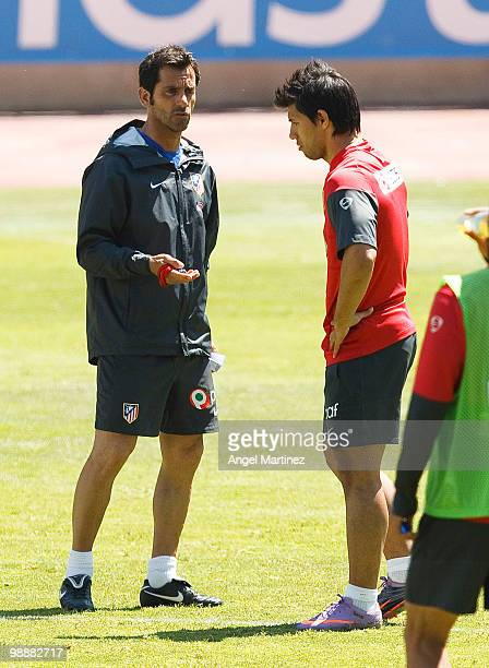 Coach Quique Sanchez Flores of Atletico Madrid chats with Sergio Aguero during a training session held ahead of next week's Europa League Final at...