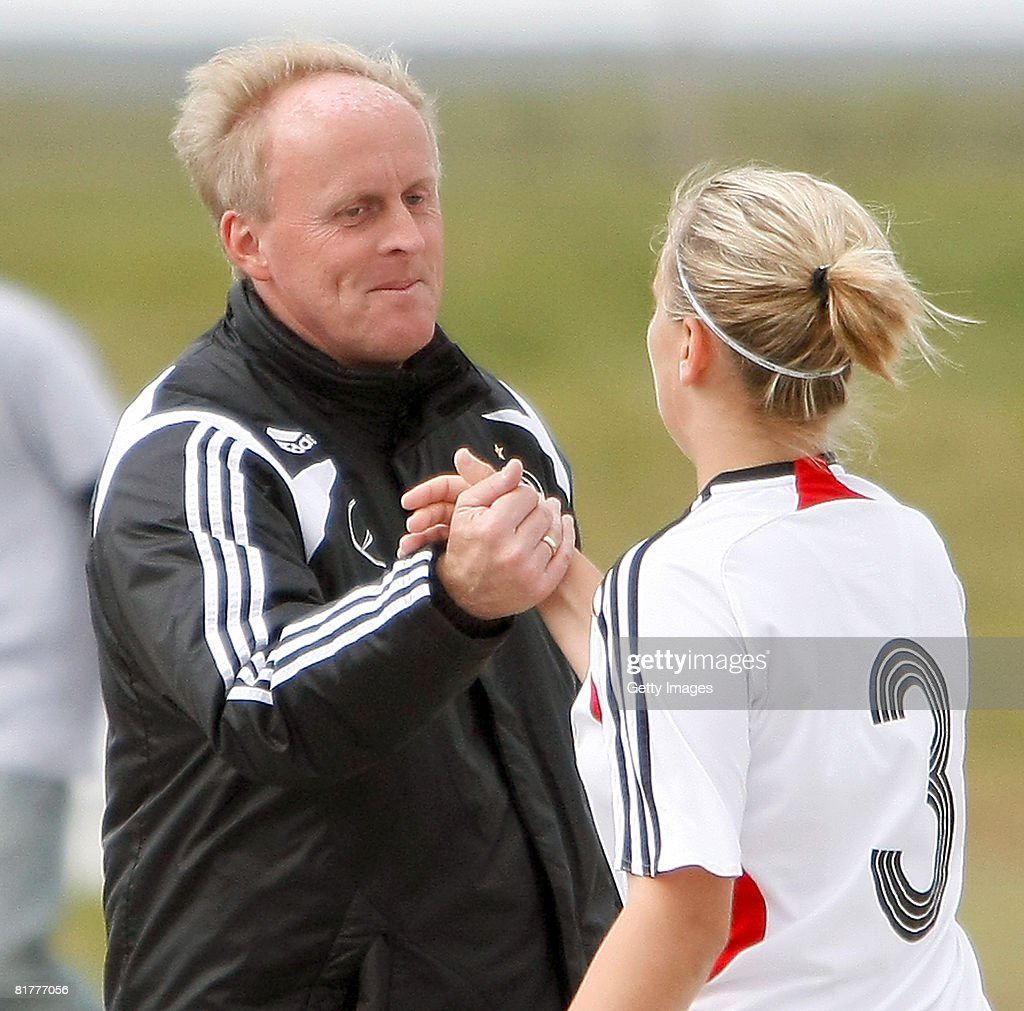 Coach Ralf Peter thanks Laura Storzel for her game during the U16 Nordic Cup match between Norway and Germany at the Hvolsvollur stadium on June 30, 2008 in Hvolsvoellur, Iceland.