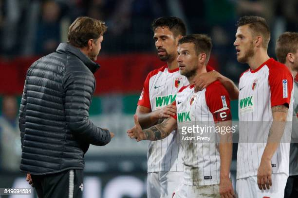 Coach Ralph Hasenhuettl of Leipzig and Daniel Baier of Augsburg get into a heated argument after the Bundesliga match between FC Augsburg and RB...