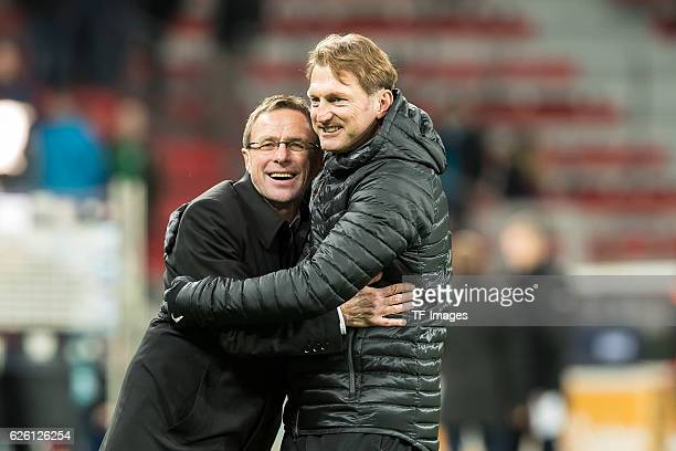 coach Ralph Hasenhuettl of RB Leipzig celebrates with Ralf Rangnick of RB Leipzig after winning the Bandesliga match between Bayer 04 Leverkusen and...