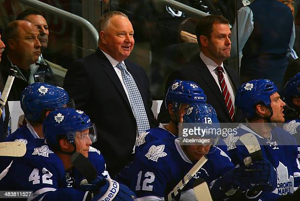 Coach Randy Carlyle of the Toronto Maple Leafs directs the team from behind the bench during NHL action against the Boston Bruins at the Air Canada...