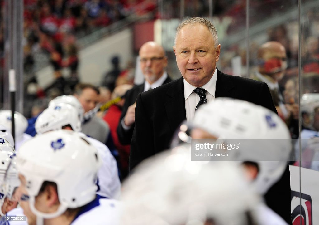Coach Randy Carlyle of the Toronto Maple Leafs watches his team plays against the Carolina Hurricanes at PNC Arena on February 14, 2013 in Raleigh, North Carolina. Carolina defeated Toronto 3-1.