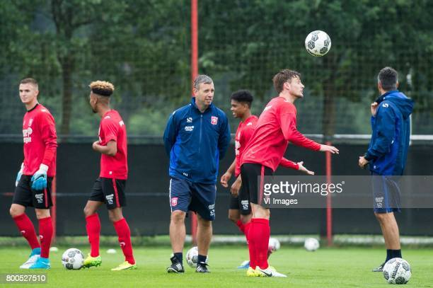 coach Rene Hake of FC Twente between his playersduring a training session at Trainingscentrum Hengelo on June 24 2017 in Hengelo The Netherlands