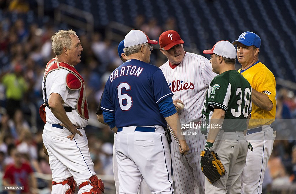 GOP coach Rep. Joe Barton, R-Texas, has a word with his players on the pitching mound during the 52nd annual Congressional Baseball Game at national Stadium in Washington on Thursday, June 13, 2013.