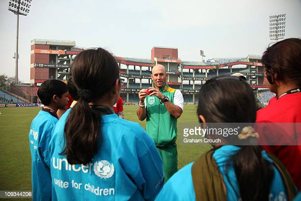 Coach Richard Pybus of the South African cricket team meets with children whose lives have been affected by HIV as part of the Think Wise initiative...