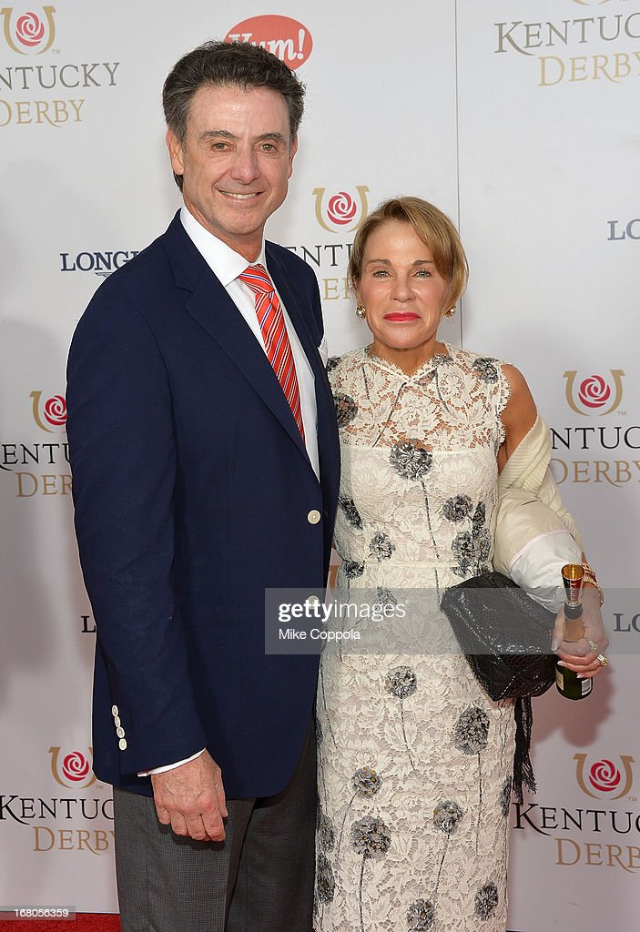 Coach Rick Pitino (R) and Joanne Minardi celebrate the 139th Kentucky Derby with Moet & Chandon at Churchill Downs on May 4, 2013 in Louisville, Kentucky.