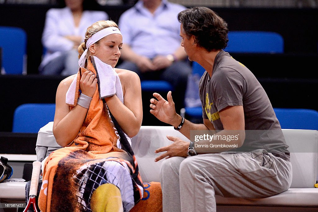 Coach Robert Orlik gives instructions to Sabine Lisicki of Germany during Day 5 of the Porsche Tennis Grand Prix at Porsche-Arena on April 26, 2013 in Stuttgart, Germany.