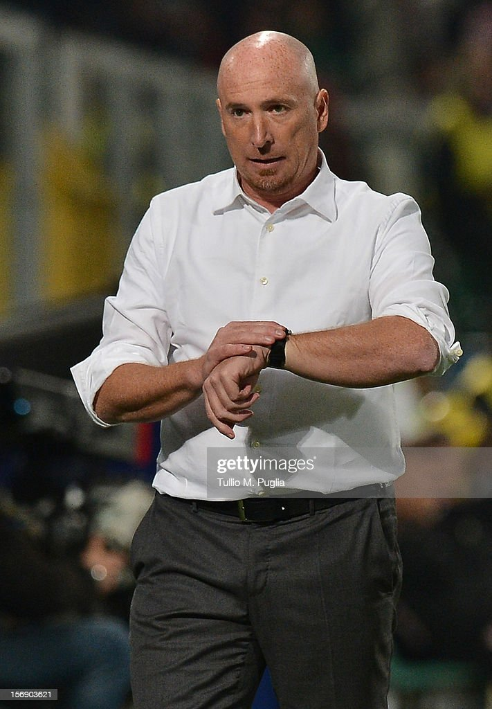 Coach Rolando Maran of Catania checks the time during the Serie A match between US Citta di Palermo and Calcio Catania at Stadio Renzo Barbera on November 24, 2012 in Palermo, Italy.