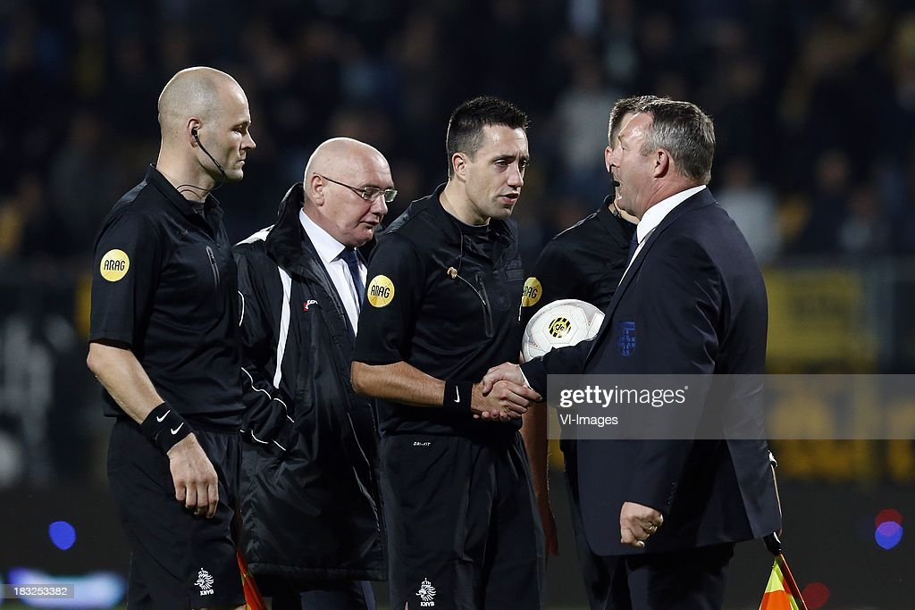Coach Ron Jans of PEC Zwolle (R), Referee Dennis Higler (CR) during the Dutch Eredivisie match between Roda JC Kerkrade and PEC Zwolle at the Parkstad Limburg on Oktober 5, 2013 in Kerkrade, The Netherlands