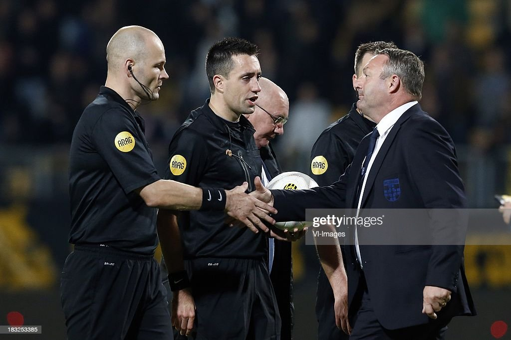 Coach Ron Jans of PEC Zwolle (R), Referee Dennis Higler (C) during the Dutch Eredivisie match between Roda JC Kerkrade and PEC Zwolle at the Parkstad Limburg on Oktober 5, 2013 in Kerkrade, The Netherlands