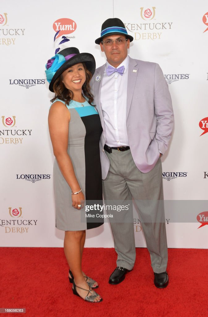 Coach <a gi-track='captionPersonalityLinkClicked' href=/galleries/search?phrase=Ron+Rivera&family=editorial&specificpeople=590509 ng-click='$event.stopPropagation()'>Ron Rivera</a> (R) and Stephanie Rivera celebrate the 139th Kentucky Derby with Moet & Chandon at Churchill Downs on May 4, 2013 in Louisville, Kentucky.