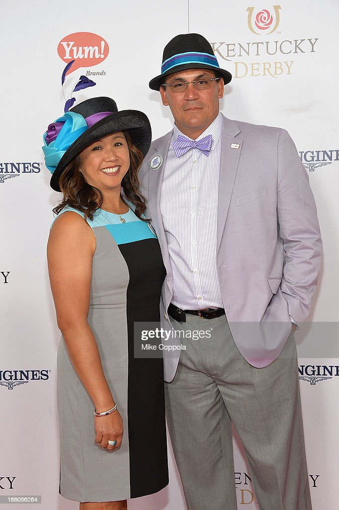 Coach Ron Rivera and Stephanie Rivera celebrate the 139th Kentucky Derby with Moet Chandon at Churchill Downs on May 4 2013 in Louisville Kentucky
