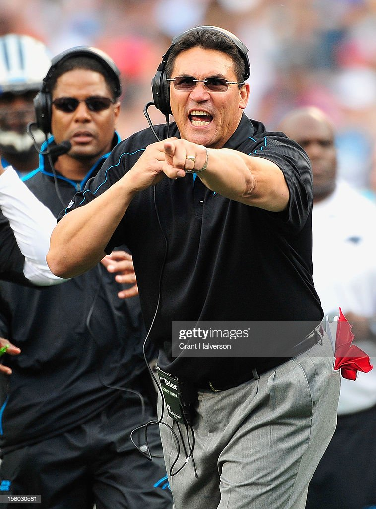 Coach <a gi-track='captionPersonalityLinkClicked' href=/galleries/search?phrase=Ron+Rivera&family=editorial&specificpeople=590509 ng-click='$event.stopPropagation()'>Ron Rivera</a> of the Carolina Panthers directs his team against the Atlanta Falcons during play at Bank of America Stadium on December 9, 2012 in Charlotte, North Carolina. Carolina defeated Atlanta, 30-20.