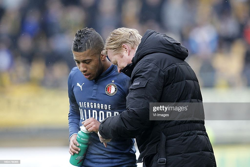 coach Ronald Koeman of Feyenoord (R), Tony Vilhena of Feyenoord (L) during the Dutch Eredivisie match between Roda JC Kerkrade and Feyenoord at the Parkstad Limburg on march 10, 2013 in Kerkrade, The Netherlands