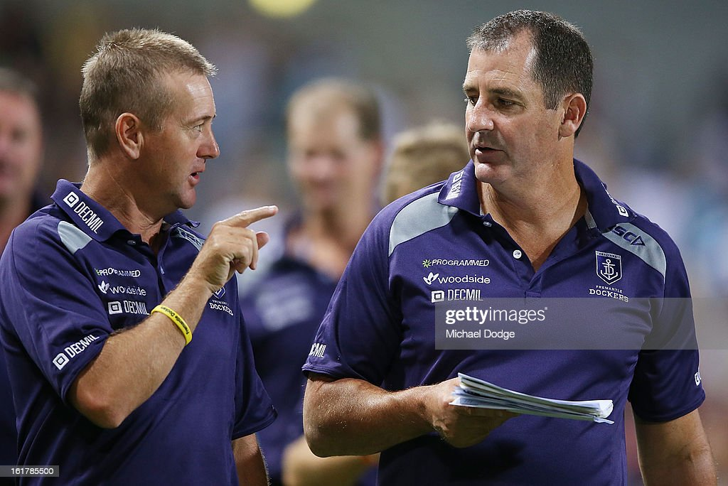 Coach Ross Lyon (R) of the Fremantle Dockers walks off after their loss in the round one NAB Cup match between the West Coast Eagles and the Fremantle Dockers at Patersons Stadium on February 16, 2013 in Perth, Australia.
