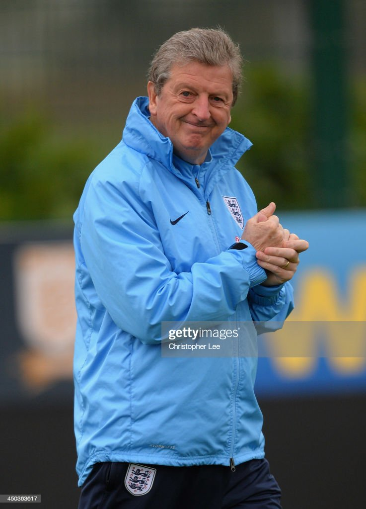 Coach <a gi-track='captionPersonalityLinkClicked' href=/galleries/search?phrase=Roy+Hodgson&family=editorial&specificpeople=881703 ng-click='$event.stopPropagation()'>Roy Hodgson</a> smiles during England Training at London Colney on November 18, 2013 in St Albans, England.