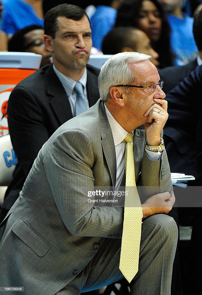 Coach Roy Williams and assistant C.B. McGrath of the North Carolina Tar Heels watch their team during a win over of the Maryland Terrapins at the Dean Smith Center on January 19, 2013 in Chapel Hill, North Carolina. North Carolina won 62-52.
