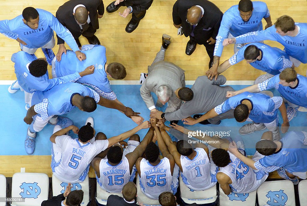 Coach Roy Williams huddles with the North Carolina Tar Heels during a game against the Florida State Seminoles at Dean Smith Center on March 3, 2013 in Chapel Hill, North Carolina. North Carolina won 79-58.