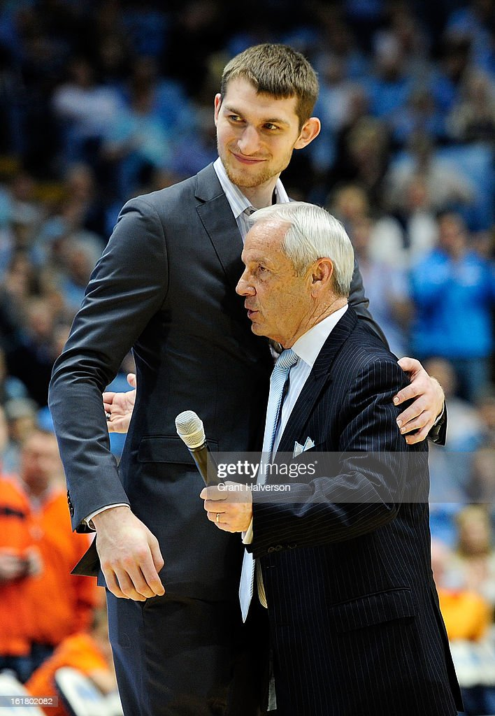 Coach Roy Williams hugs former North Carolina Tar Heels player Tyler Zeller as Zeller's jersey number is honored during a ceremony at halftime of the game against the Virginia Cavaliers at the Dean Smith Center on February 16, 2013 in Chapel Hill, North Carolina. North Carolina won 93-81.