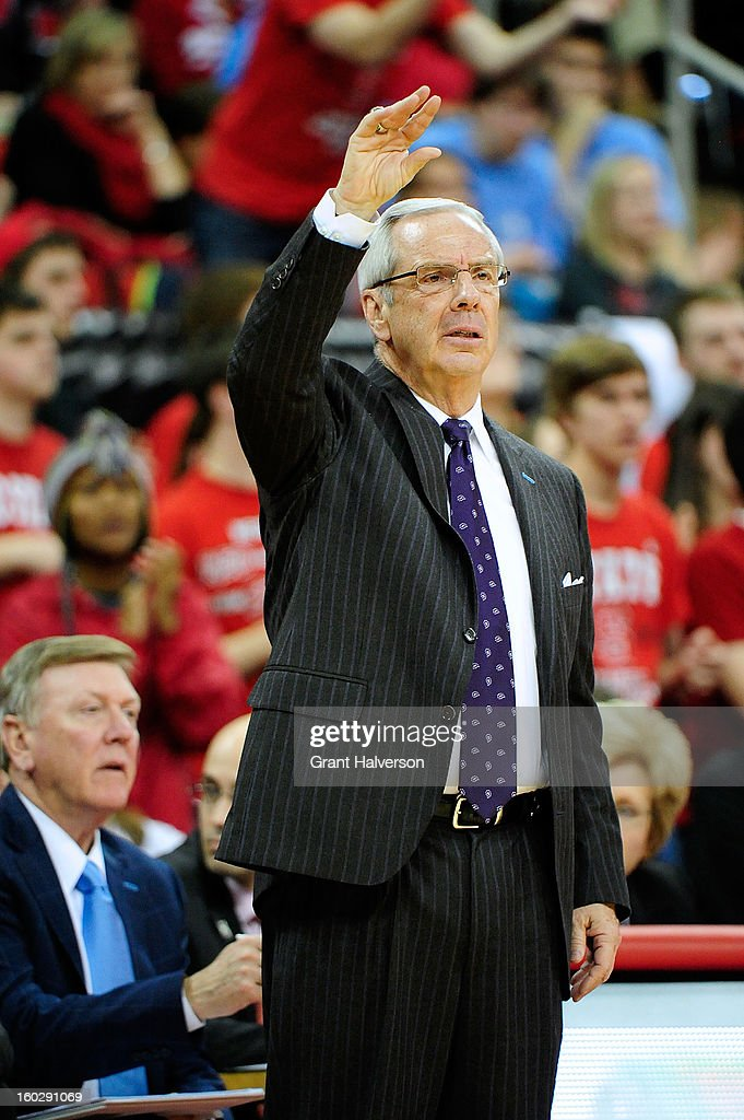 Coach Roy Williams of the North Carolina Tar Heels calls instructions to his team against the North Carolina State Wolfpack during play at PNC Arena on January 26, 2013 in Raleigh, North Carolina. North Carolina State won 91-83.