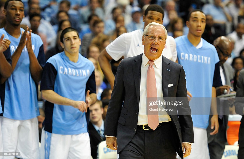 Coach Roy Williams of the North Carolina Tar Heels calls instructions to his team during a game against the Oakland Golden Grizzlies at the Dean Smith Center on November 8, 2013 in Chapel Hill, North Carolina. North Carolina won 84-61.