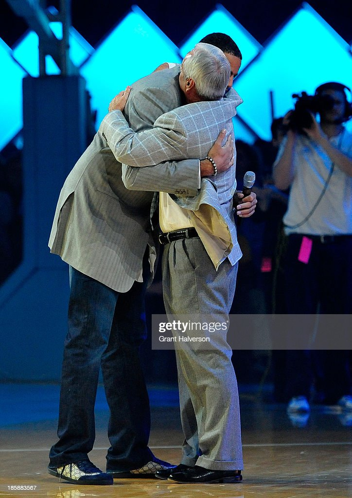 Coach Roy Williams of the North Carolina Tar Heels embraces former player <a gi-track='captionPersonalityLinkClicked' href=/galleries/search?phrase=Sean+May&family=editorial&specificpeople=200726 ng-click='$event.stopPropagation()'>Sean May</a> during Late Night with Roy Williams at the Dean Smith Center on October 25, 2013 in Chapel Hill, North Carolina.