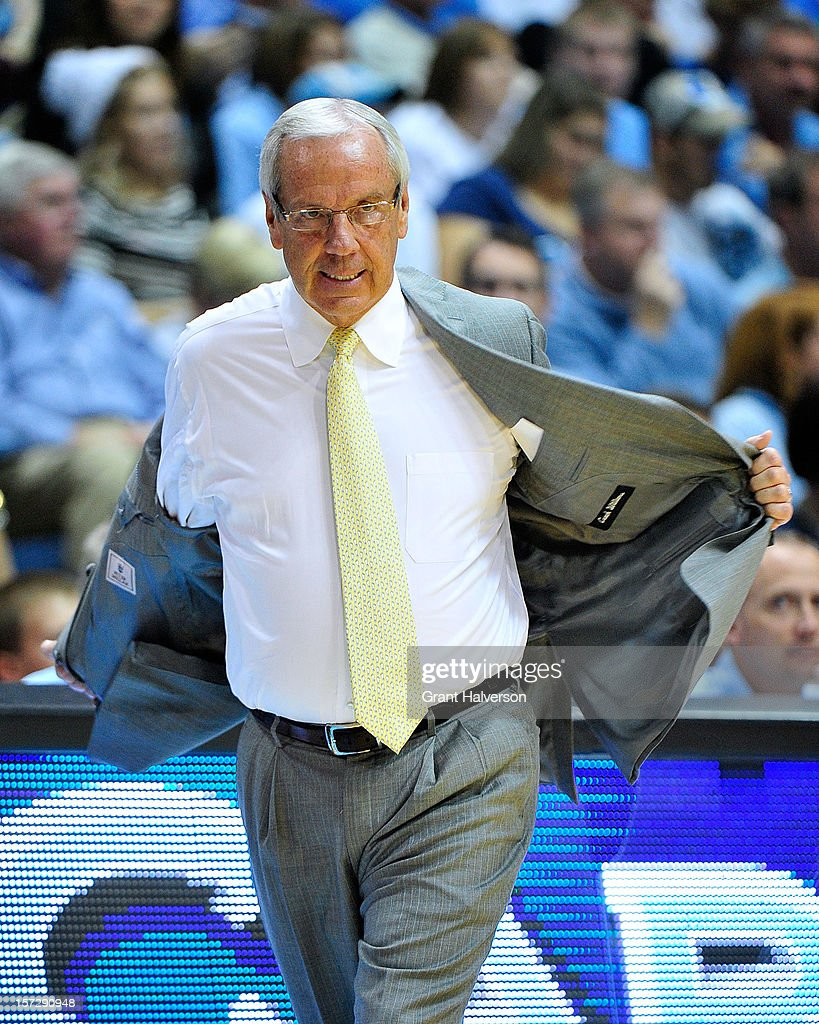 Coach Roy Williams of the North Carolina Tar Heels rips his jacket off in a anger after his team committed a turnover against the UAB Blazers during play at the Dean Smith Center on December 1, 2012 in Chapel Hill, North Carolina. North Carolina won 102-84.