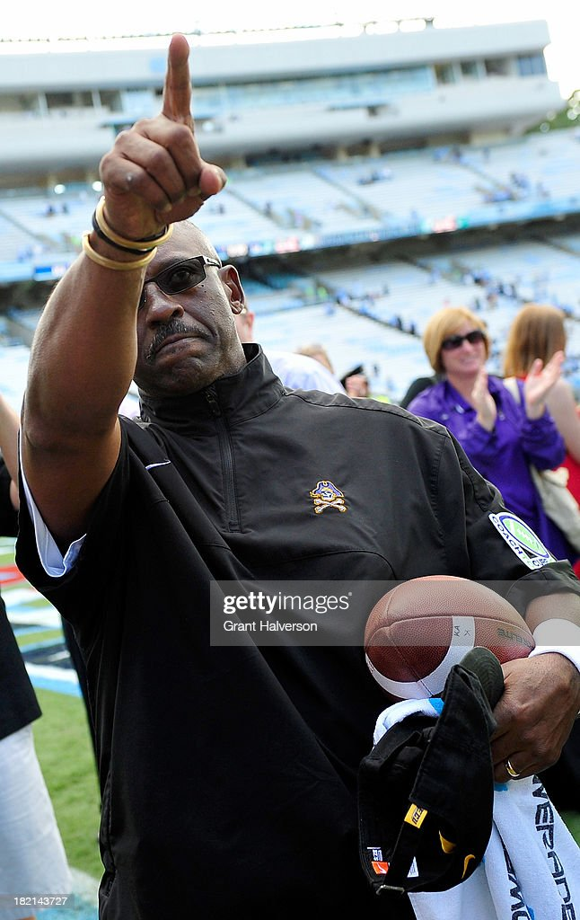 Coach Ruffin McNeill of the East Carolina Pirates salutes the fans after a win over the North Carolina Tar Heels at Kenan Stadium on September 28, 2013 in Chapel Hill, North Carolina. East Carolina won 55-31.