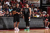 Coach Ryan Saunders of the Minnesota Timberwolves and Tyus Jones of the Minnesota Timberwolves talk during the game against the Chicago Bulls during...