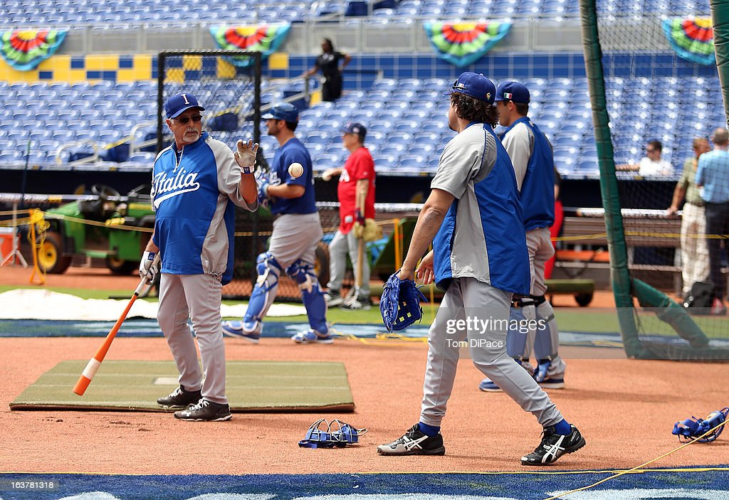 Coach Sam Perlazzo and <a gi-track='captionPersonalityLinkClicked' href=/galleries/search?phrase=Mike+Piazza&family=editorial&specificpeople=201920 ng-click='$event.stopPropagation()'>Mike Piazza</a> of Team Italy during the workout day for the 2013 World Baseball Classic on March 11, 2013 at Marlins Park in Miami, Florida.