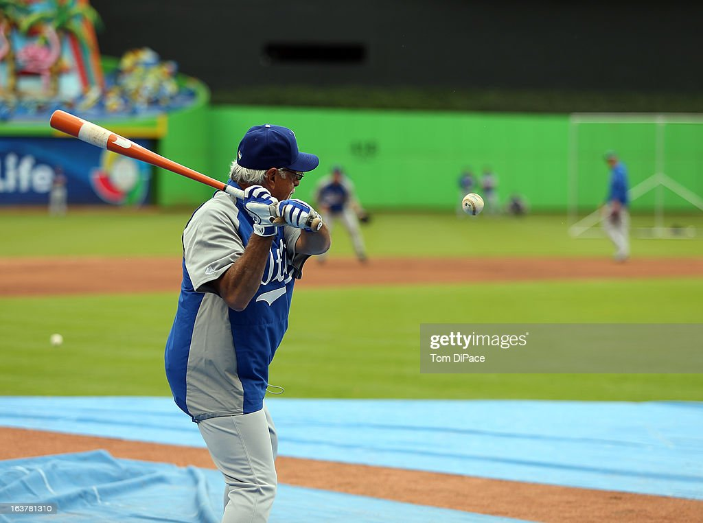 Coach Sam Perlazzo of Team Italy hits balls during the workout day for the 2013 World Baseball Classic on March 11, 2013 at Marlins Park in Miami, Florida.
