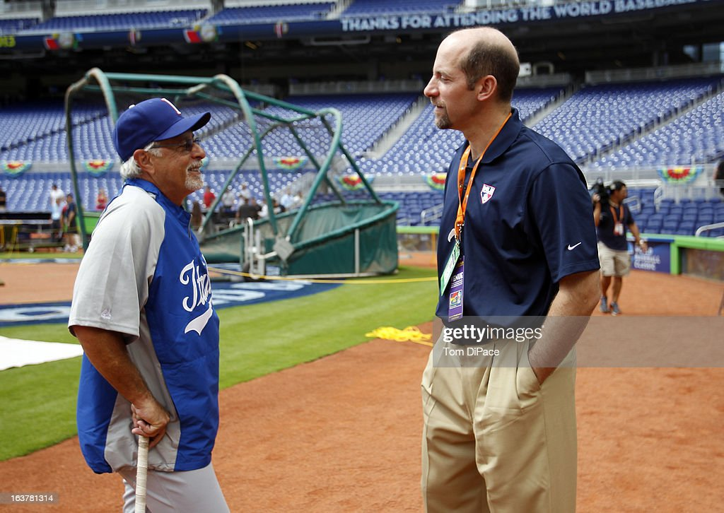 Coach Sam Perlazzo of Team Italy talks with MLB Network Analyst <a gi-track='captionPersonalityLinkClicked' href=/galleries/search?phrase=John+Smoltz&family=editorial&specificpeople=176519 ng-click='$event.stopPropagation()'>John Smoltz</a> during the workout day for the 2013 World Baseball Classic on March 11, 2013 at Marlins Park in Miami, Florida.