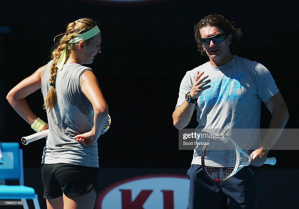 Coach Samuel Sumyk speaks to <a gi-track='captionPersonalityLinkClicked' href=/galleries/search?phrase=Victoria+Azarenka&family=editorial&specificpeople=604872 ng-click='$event.stopPropagation()'>Victoria Azarenka</a> of Belarus during a practice session ahead of the 2013 Australian Open at Melbourne Park on January 7, 2013 in Melbourne, Australia.