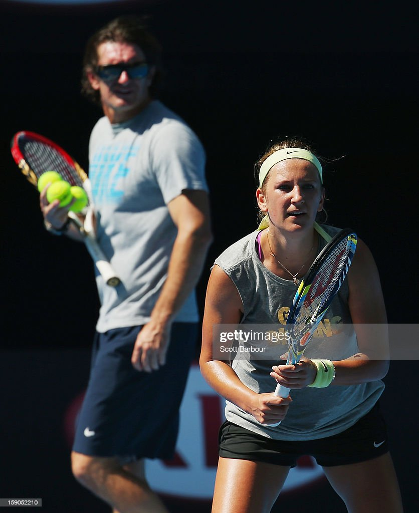 Coach Samuel Sumyk watches <a gi-track='captionPersonalityLinkClicked' href=/galleries/search?phrase=Victoria+Azarenka&family=editorial&specificpeople=604872 ng-click='$event.stopPropagation()'>Victoria Azarenka</a> of Belarus during a practice session ahead of the 2013 Australian Open at Melbourne Park on January 7, 2013 in Melbourne, Australia.
