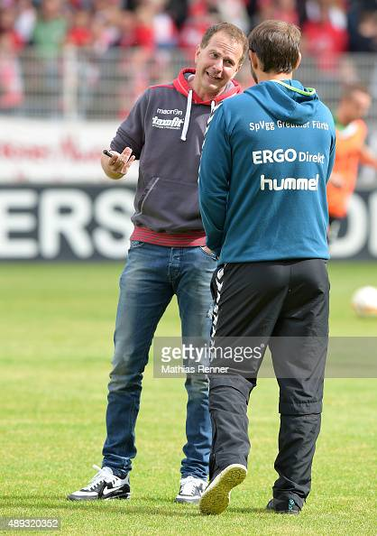 coach Sascha Lewandowski of 1 FC Union Berlin and coach Stefan Ruthenbeck of SpVgg Greuther Fuerth chat during the game between Union Berlin and...