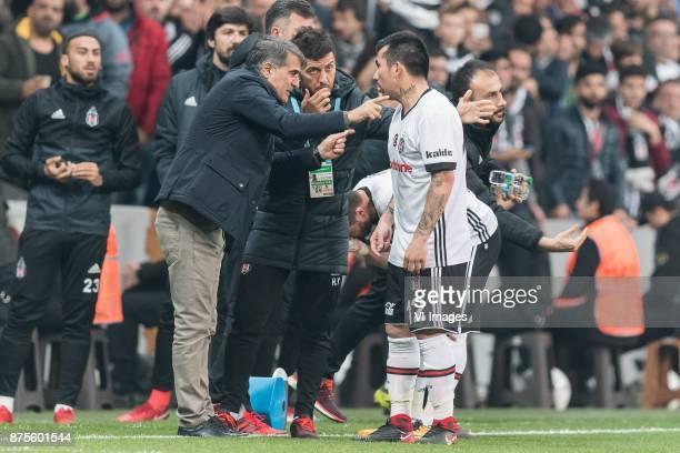 coach Senol Gunes of Besiktas JK give instructions to Gary Alexis Medel Soto of Besiktas JK during the Turkish Spor Toto Super Lig football match...