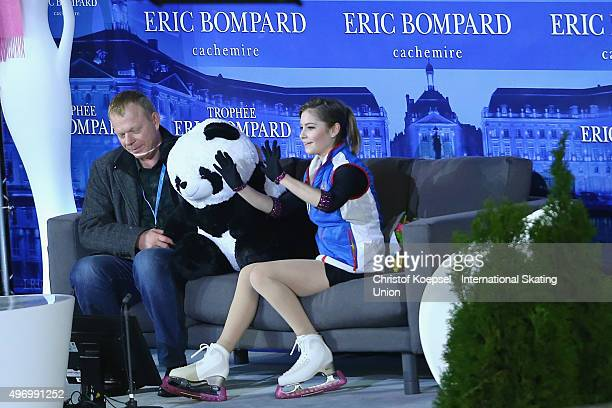 Coach Sergei Dudakov and Julia Lipnitskaia of Russia wait for the results during the ladies short program of the ISU Grand Prix at Meriadeck Ice Rink...