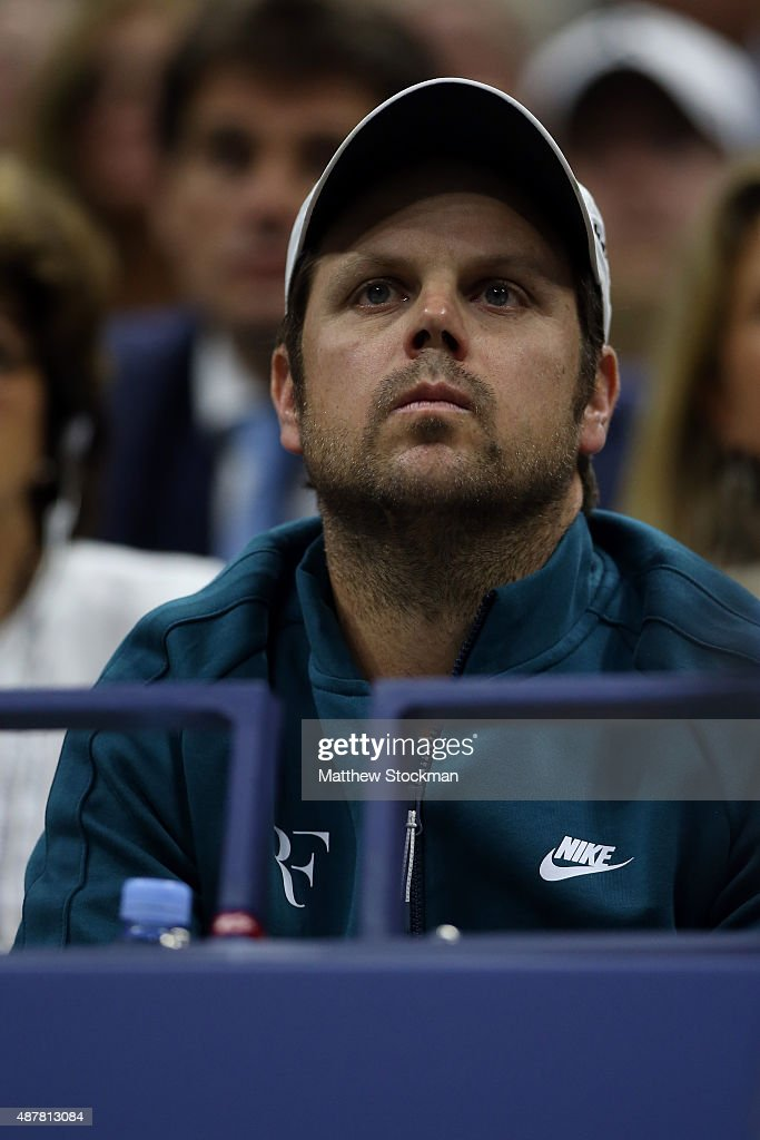 Coach Severin Luthi watches Roger Federer of Switzerland play against Stan Wawrinka of Switzerland during their Men's Singles Semifinals match on Day Twelve of the 2015 US Open at the USTA Billie Jean King National Tennis Center on September 11, 2015 in the Flushing neighborhood of the Queens borough of New York City.