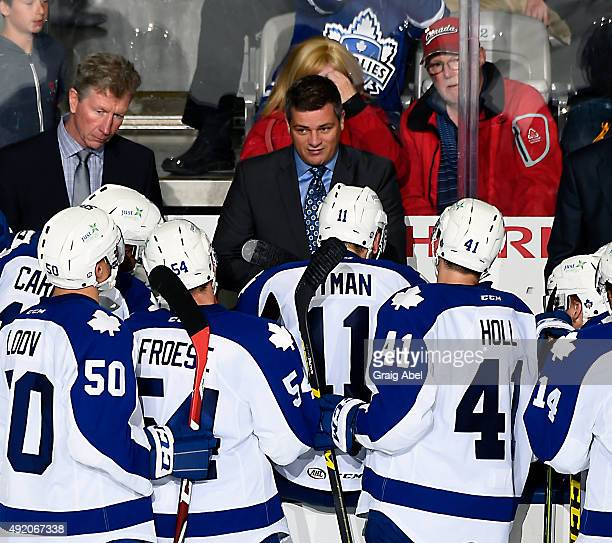 Coach Sheldon Keefe of the Toronto Marlies talks to his during team during Opening Night AHL game action against the Manitoba Moose on October 9 2015...