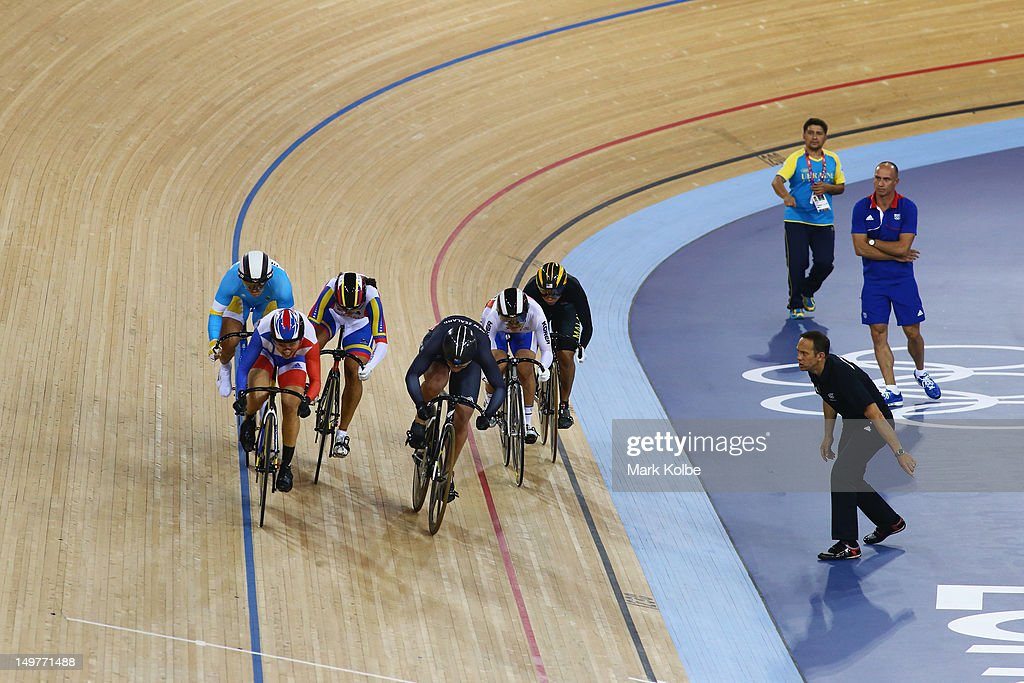 A coach shouts instructions to his rider in the Women's Keirin Track Cycling at the Velodrome on August 3, 2012 in London, England.