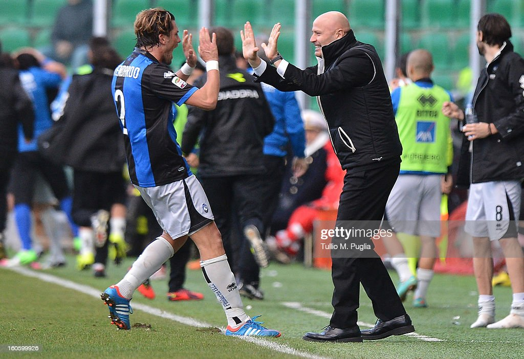 Coach Stefano Colantuono and Guglielmo Stendardo of Atalanta celebrate the team's second goal during the Serie A match between US Citta di Palermo and Atalanta BC at Stadio Renzo Barbera on February 3, 2013 in Palermo, Italy.