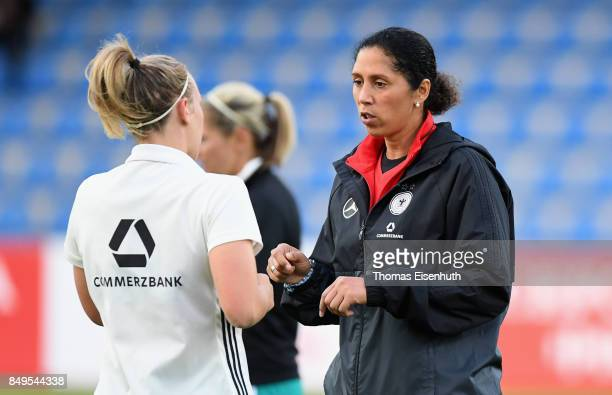 Coach Steffi Jones of Germany speaks to Kristin Demann prior the 2019 FIFA Women's World Championship Qualifier match between Czech Republic Women's...