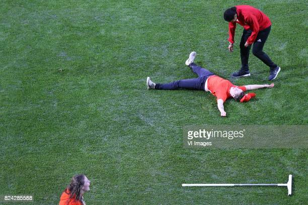 coach Steffi Jones of Germany women volontair tries to shoot a ball in the wet grass and falls during the UEFA WEURO 2017 quarter finale match...
