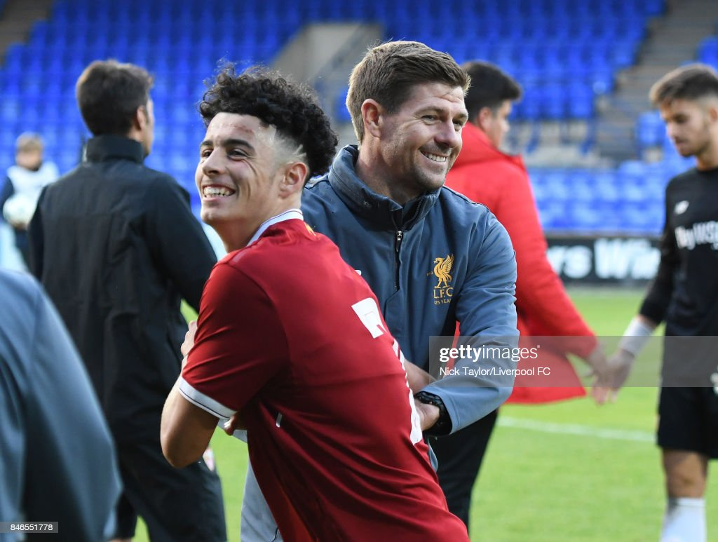 Coach Steven Gerrard celebrates with his player Curtis Jones of Liverpool after the UEFA Champions League group E match between Liverpool FC and Sevilla FC at Prenton Park on September 13, 2017 in Birkenhead, United Kingdom.
