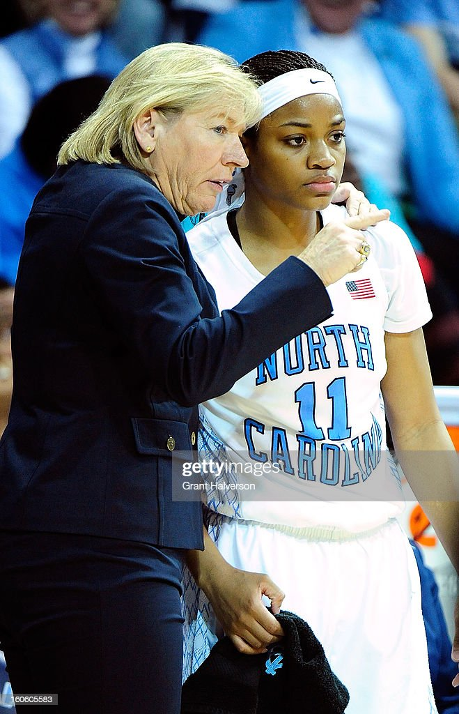 Coach Sylvia Hatchell huddles with Brittany Rountree #11 of the North Carolina Tar Heels during a loss to the Duke Blue Devils at Carmichael Arena on February 3, 2013 in Chapel Hill, North Carolina. Duke won 84-63.